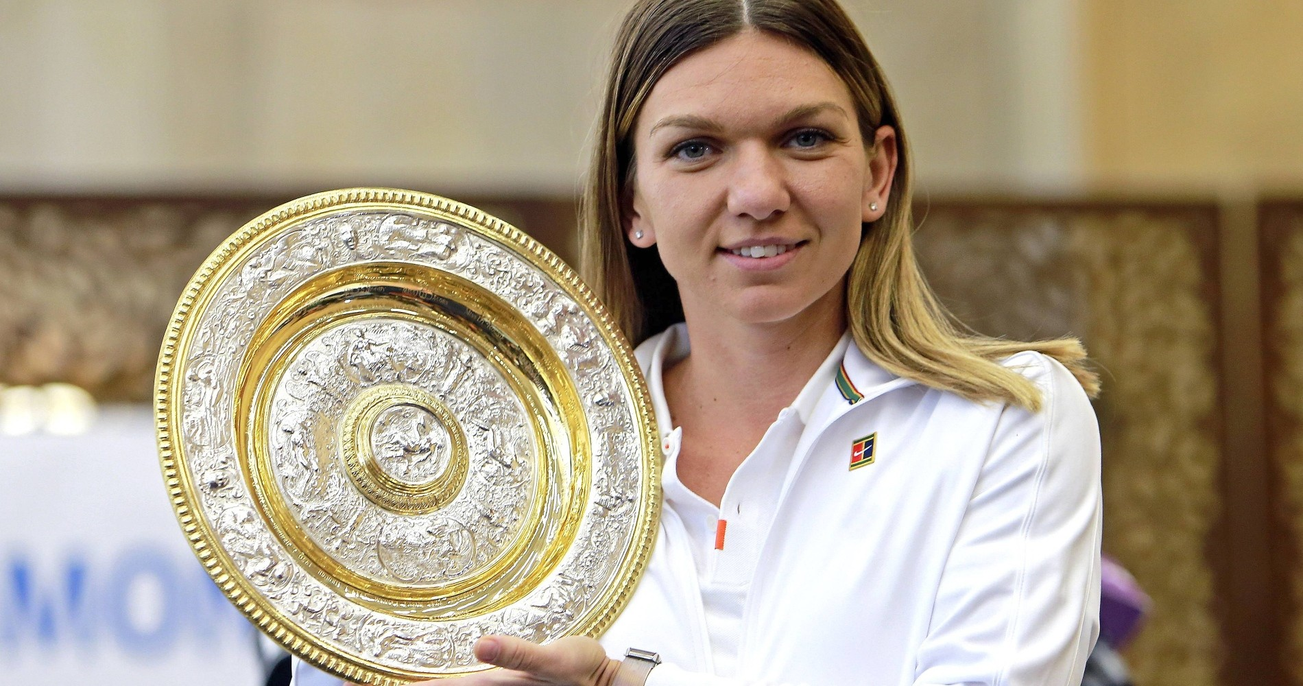 Simona Halep with her 2019 Wimbledon trophy in Bucharest
