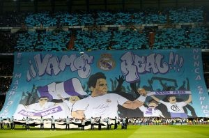 Real Madrid fans hold up a banner displaying an image of Rafael Nadal.