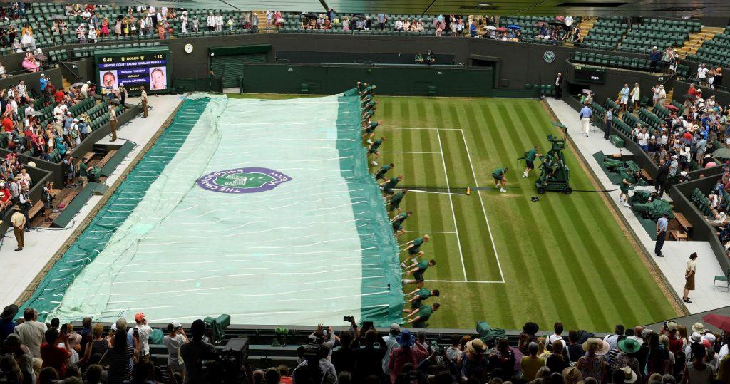 Ball boys covering Wimbledon Centre court