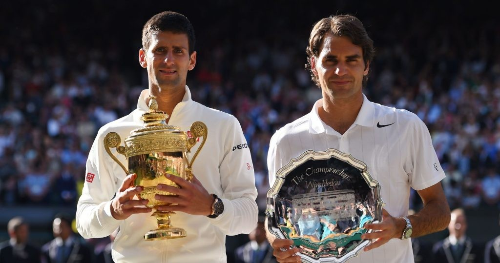 Djokovic and Federer pose with their trophies in Wimbledon in 2014