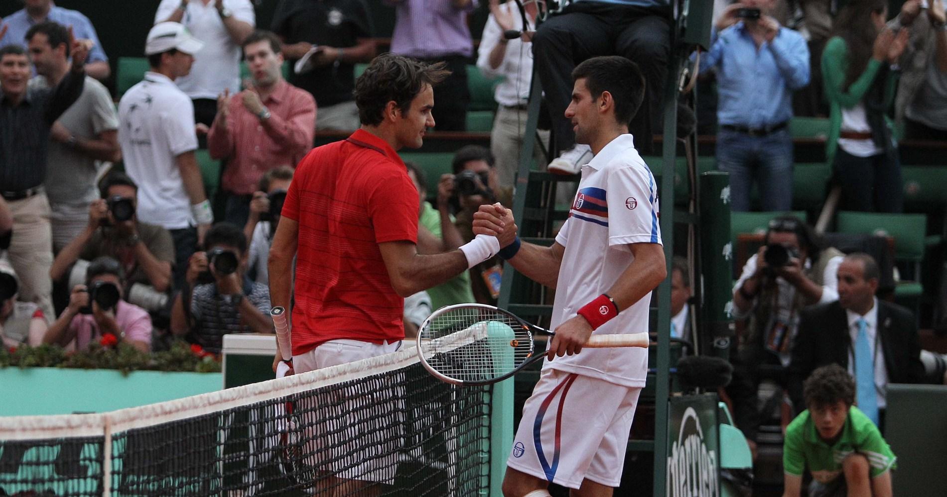 Roger Federer and Novak Djokovic shake hands after their 2011 semi-final in Paris.