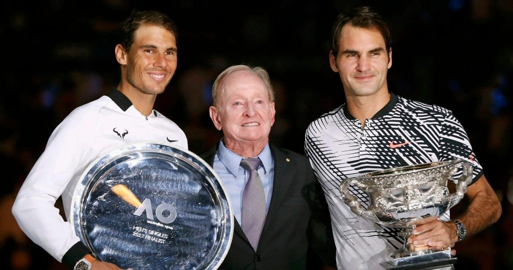 Roger Federer and Rafael Nadal pose with Rod Laver and their trophies in Australia in 2017