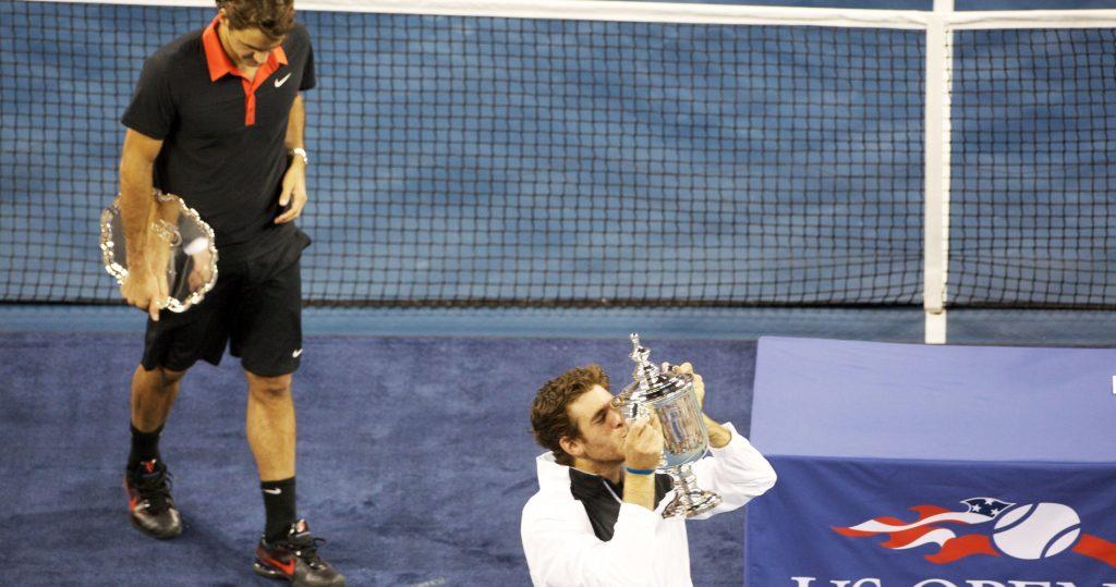 2009 US Open winner Juan Martin Del Potro with runner-up Roger Federer in the back