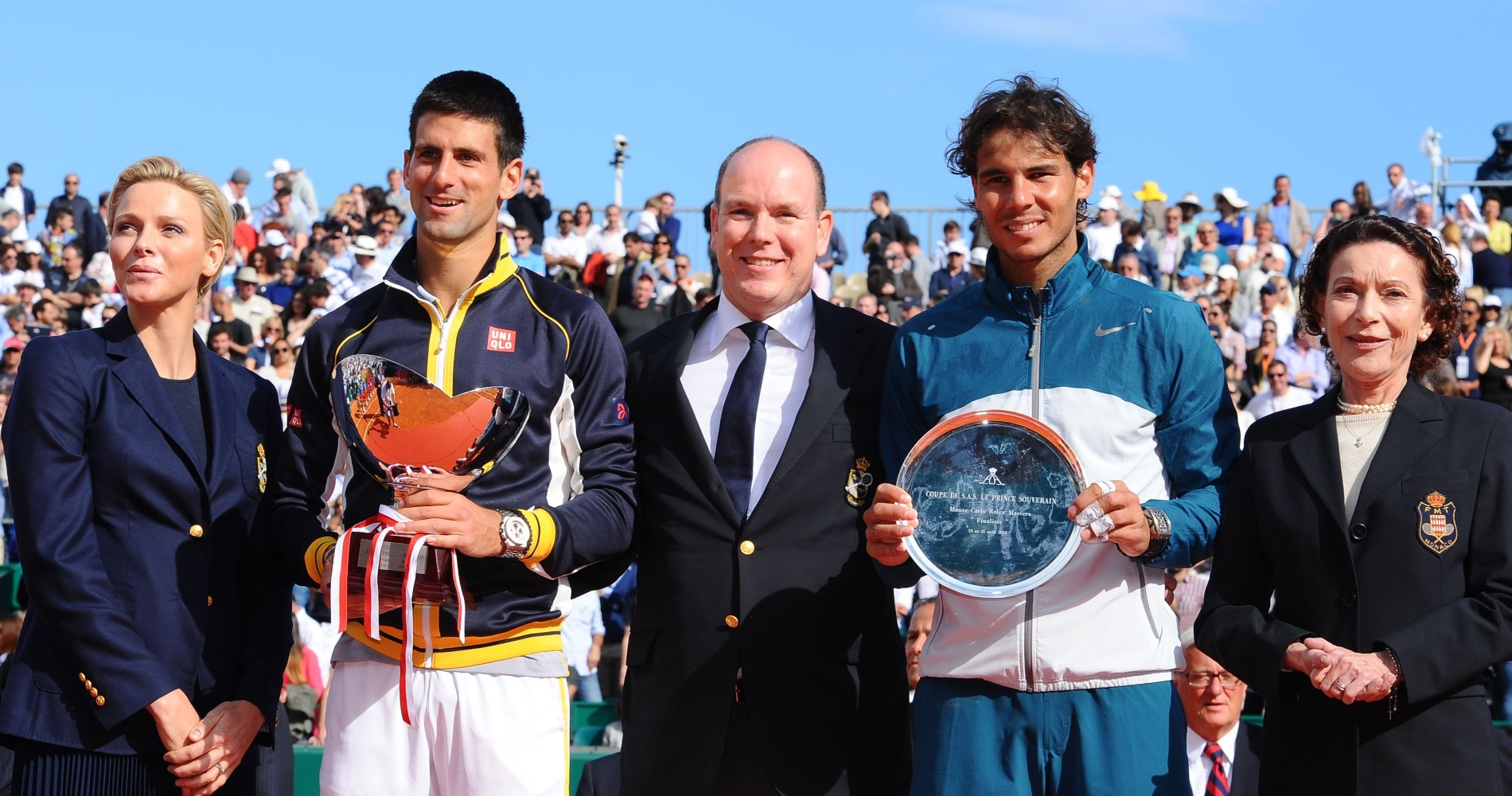 Novak Djokovic and Rafael Nadal pose with their trophies after the 2013 final.