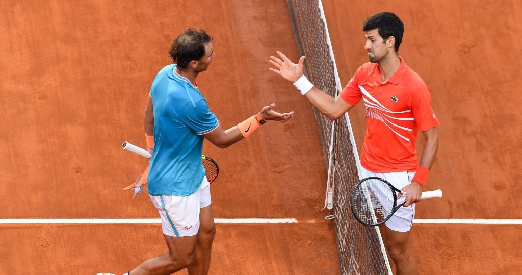 Novak Djokovic and Rafael Nadal at the net after their 54th meeting in Rome in 2019.