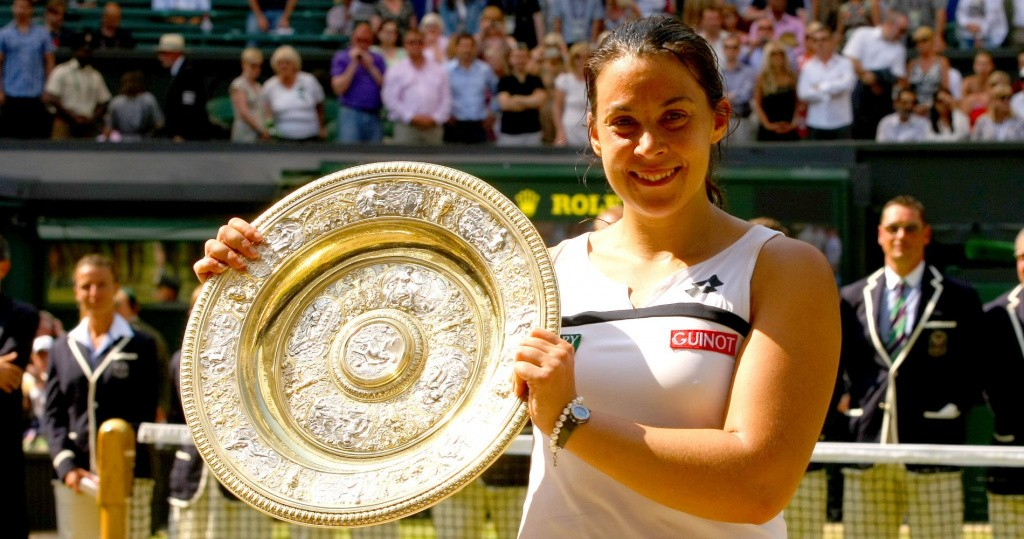 Marion Bartoli of France celebrates with the trophy at The Championships, Wimbledon, 2013. -------------------- Ella Ling / BPI Wimbledon - Day Twelve Wimbledon - Day Twelve 06 July 2013 Javier Garcia +447887794393 info@backpageimages.com http://www.backpageimages.com