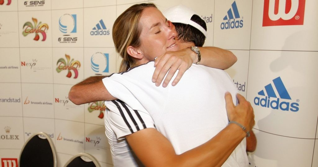 Justine Henin with her coach Carlos Rodriguez