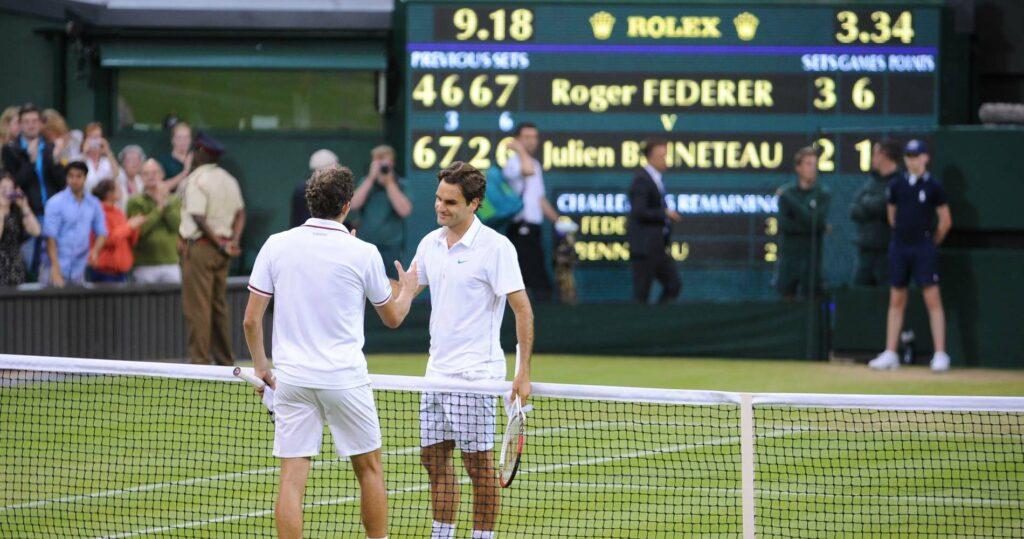 Roger Federer & Julien Benneteau at Wimbledon in 2012