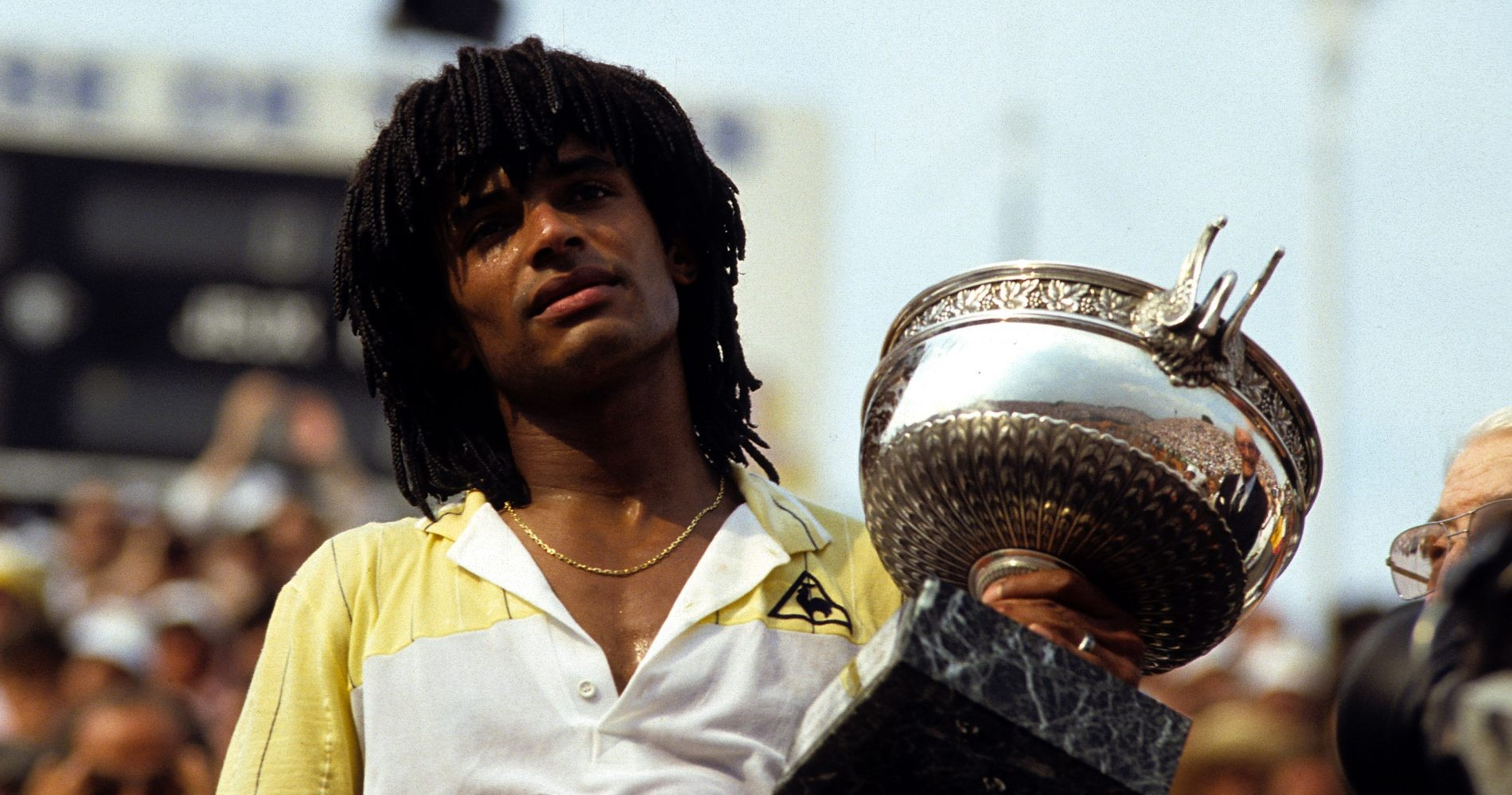 Yannick Noah lifting the Roland Garros trophy