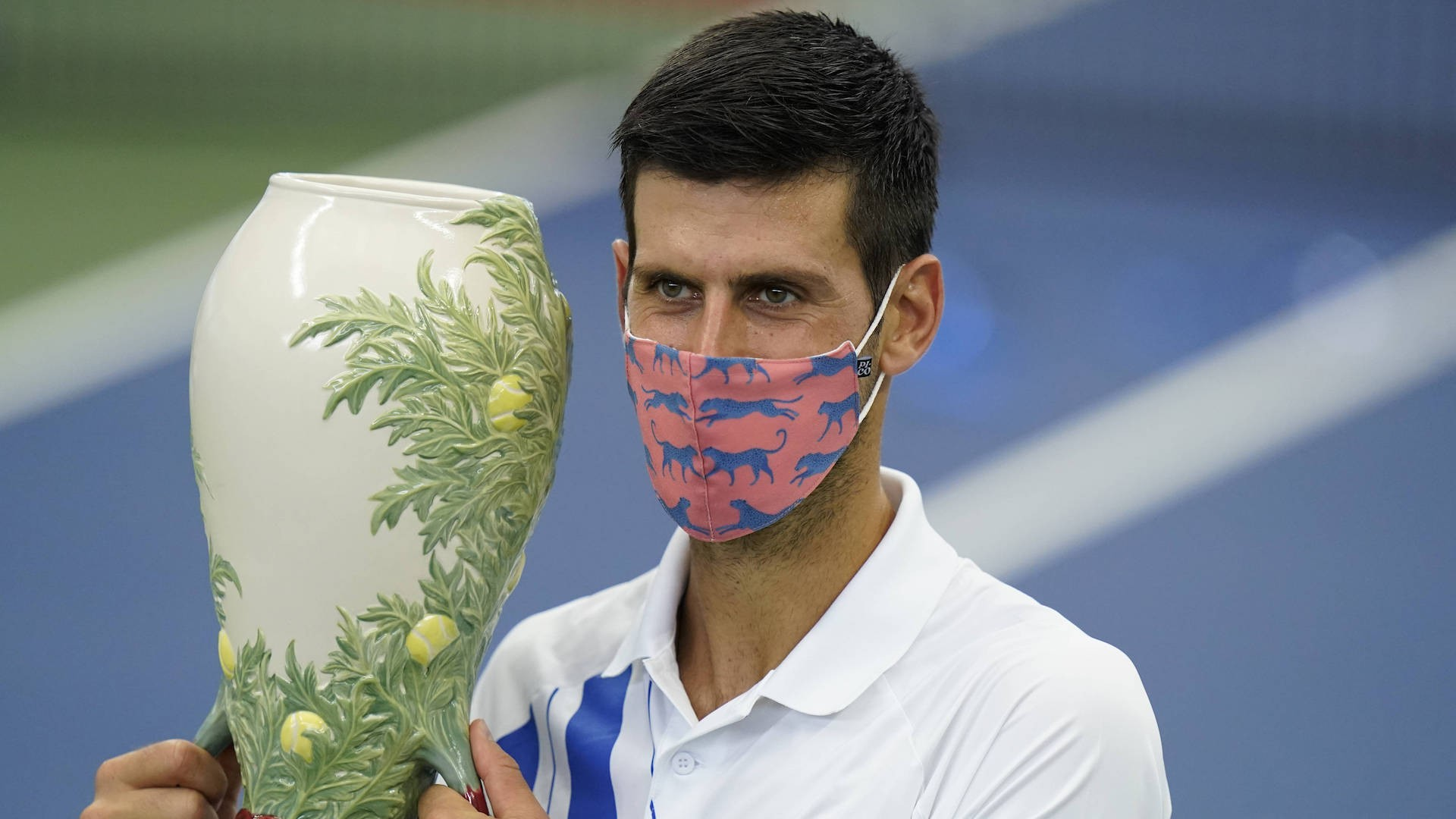 Novak Djokovic holds his winning trophy after winning final with Milos Raonic, Western and Southern Open, August 2020