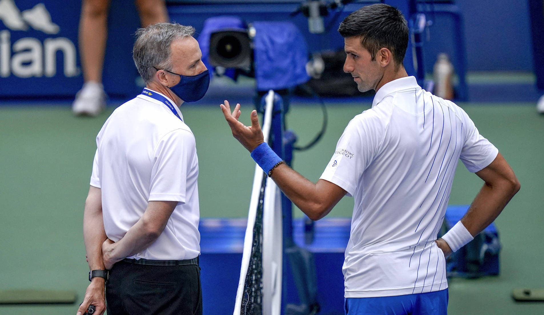 Novak Djokovic, of Serbia, talks with the umpire after inadvertently hitting a line judge with a ball after hitting it in reaction to losing a point against Pablo Carreno Busta, of Spain, during the fourth round of the US Open tennis championships, Sunday, Sept. 6, 2020, in New York. Djokovic defaulted the match. (AP Photo/Seth Wenig)/USO169/20250742484133//2009062231