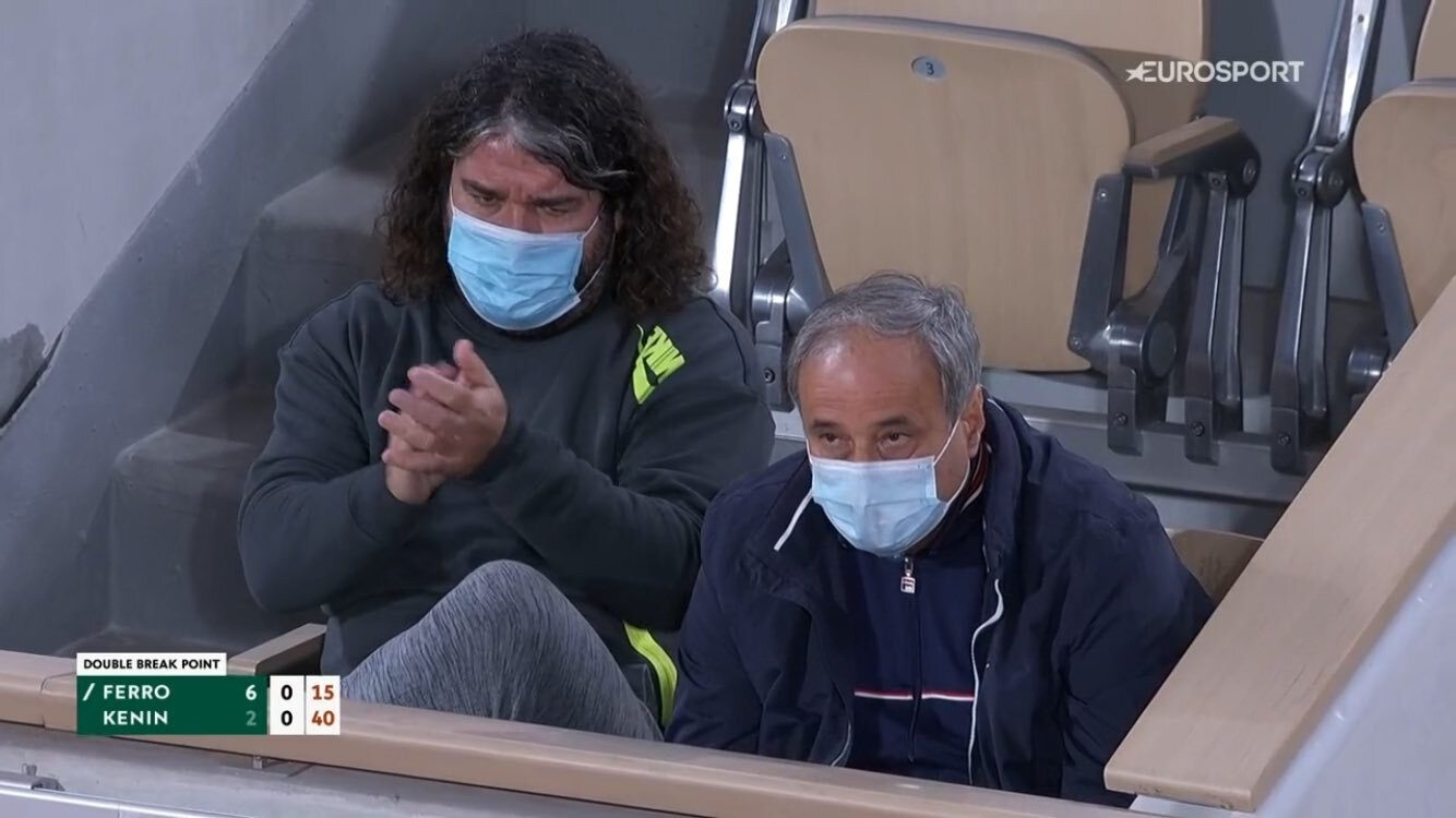 Emmanuel Planque and Alex Kenin sitting next to each other during their players' match