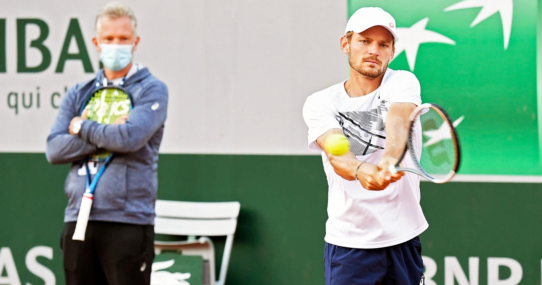 David Goffin with Thomas Johansson looking on