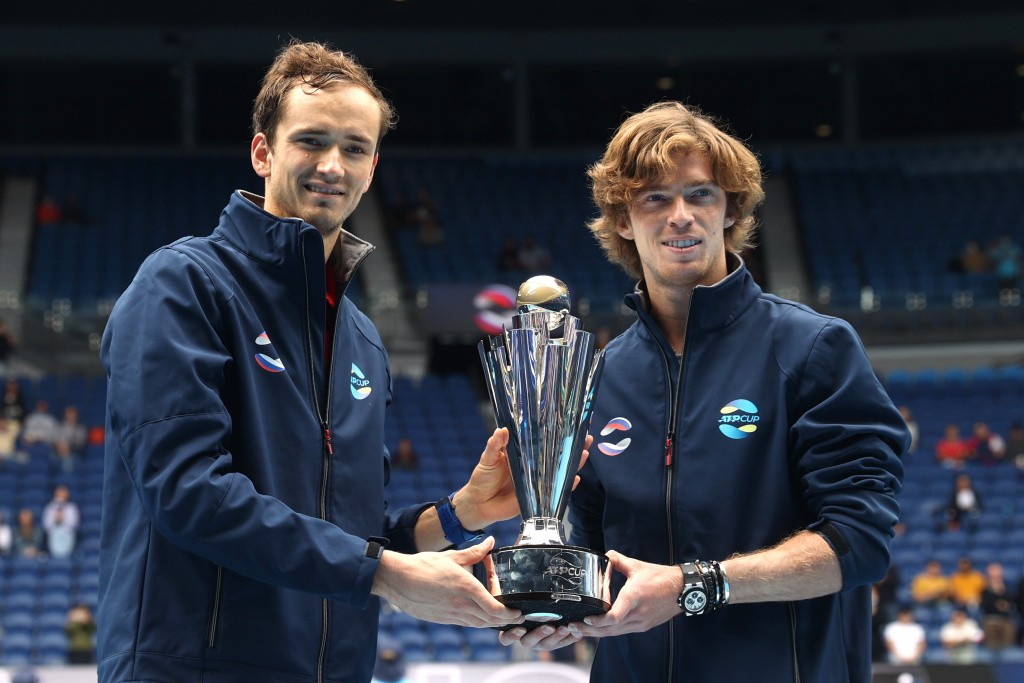 Tennis - ATP Cup - Melbourne Park, Melbourne, Australia, February 7, 2021 Russia's Daniil Medvedev and Andrey Rublev celebrate winning the ATP Cup with the trophy after their final against Italy