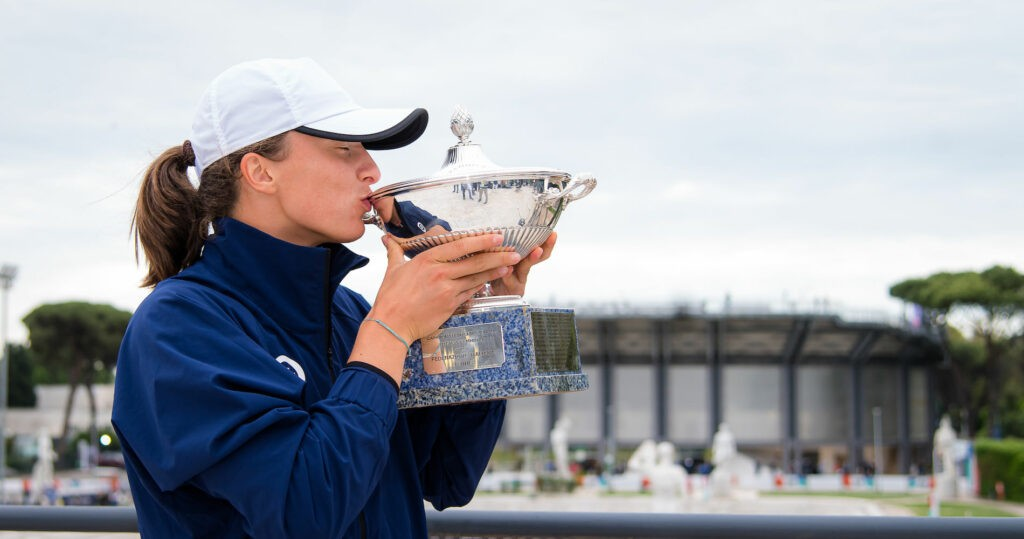 Iga Swiatek of Poland poses with her champions trophy after winning the final in Rome