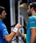 Tennis - ATP Finals - The O2, London, Britain - November 10, 2019 Serbia's Novak Djokovic shakes hands with Italy's Matteo Berrettini after winning their group stage match
