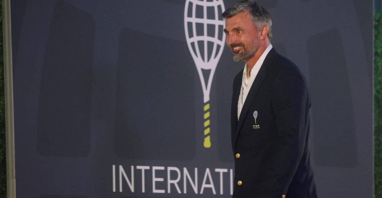 Former tennis player Goran Ivanisevic of Croatia smiles after being inducted into the International Tennis Hall of Fame