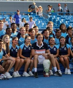 Daniil Medvedev of Russia poses for a photo with volunteers with the Rookwood Cup trophy after winning the Western & Southern Open at Lindner Family Tennis Center on August 18, 2019 in Mason, Ohio