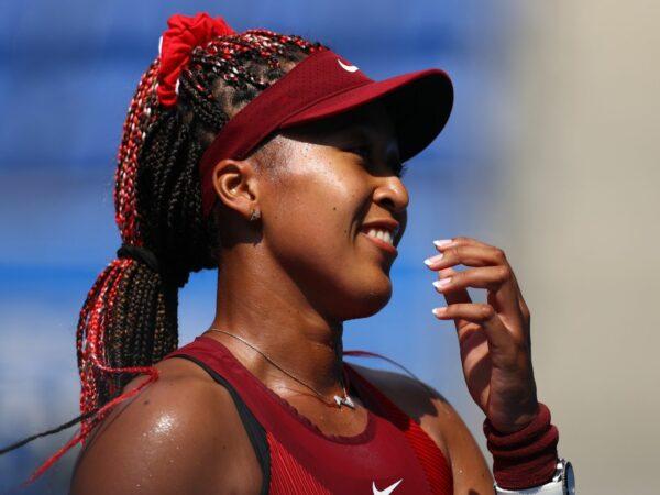 Ariake Tennis Park - Tokyo, Japan - July 25, 2021. Naomi Osaka of Japan celebrates after winning her first round match against Zheng Saisai of China
