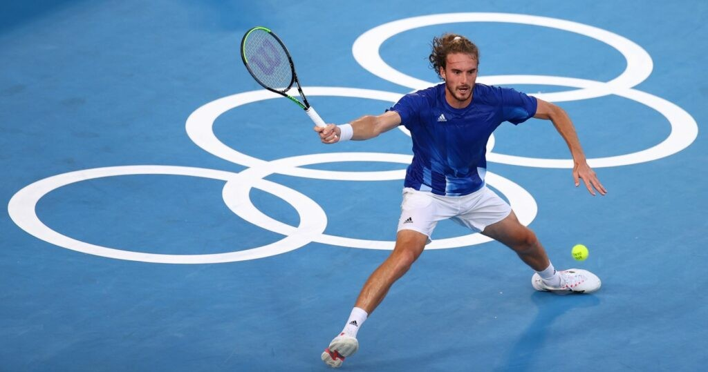mpics - Tennis - Men's Singles - Round 1 - Ariake Tennis Park - Tokyo, Japan - July 25, 2021. Stefanos Tsitsipas of Greece in action during his first round match against Philipp Kohlschreiber of Germany REUTERS/Edgar Su / Panoramic