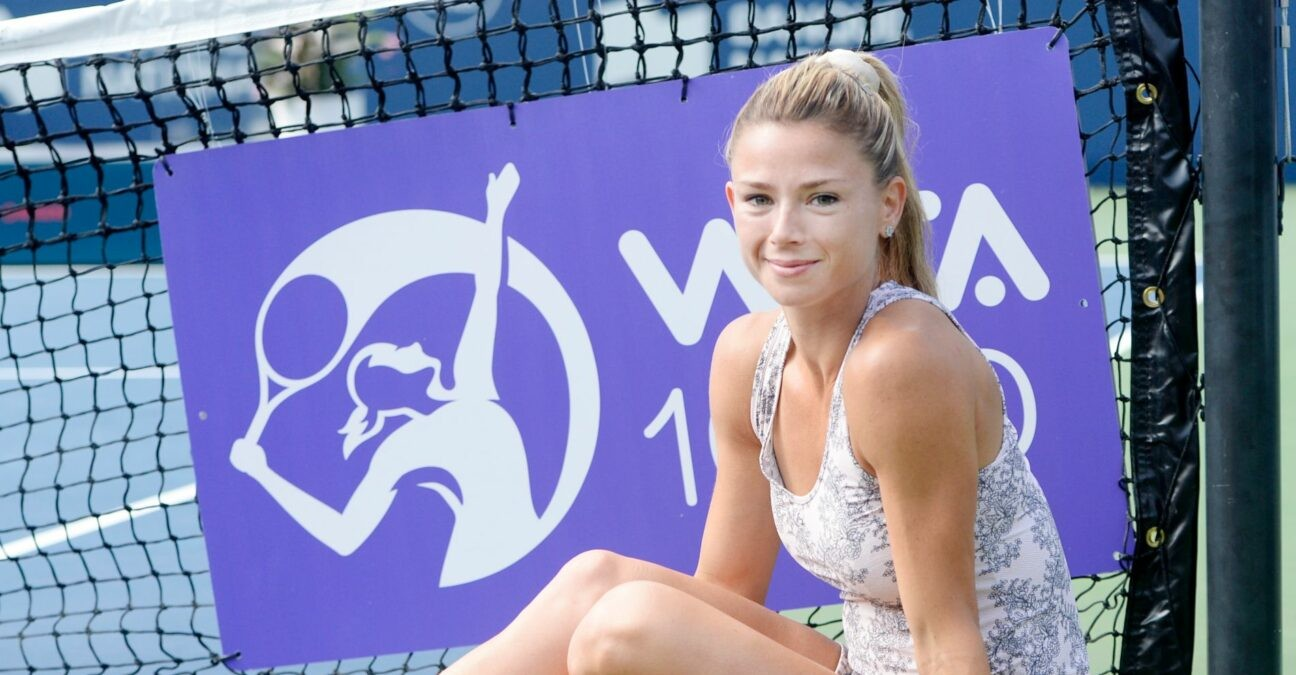 Camila Giorgi of Italy poses with the championship trophy after winning the womens singles final at the National Bank Open at Stade IGA