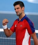 Men's Singles - Quarterfinal - Ariake Tennis Park - Tokyo, Japan - July 29, 2021 Novak Djokovic of Serbia celebrates after winning his quarterfinal match against Kei Nishikori of Japan