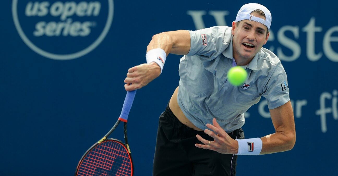 John Isner (USA) serves the ball against Cameron Norrie (GBR) during the Western and Southern Open tennis tournament at Lindner Family Tennis Center