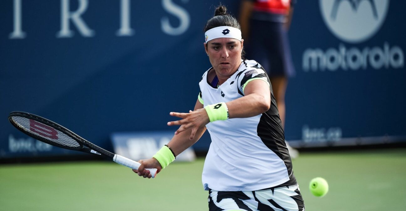 MONTREAL, QC - AUGUST 09: Ons Jabeur (TUN) returns the ball during the first round WTA National Bank Open match on August 9, 2021 at IGA Stadium in Montreal, QC