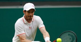 Britain's Andy Murray in action during his first round match at Wimbledon 2021