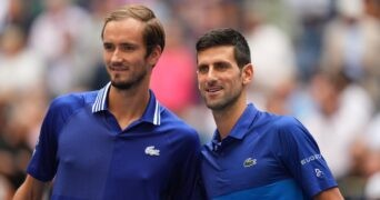 Danill Medvedev of Russia and Novak Djokovic of Serbia pose for a photo together before the men's singles final on day fourteen of the 2021 U.S. Open tennis tournament at USTA Billie Jean King National Tennis Center.