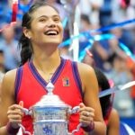 Emma Raducanu of Great Britain celebrates with the championship trophy after her match on day thirteen of the 2021 U.S. Open tennis tournament at USTA Billie Jean King National Tennis Center.