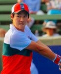 Soonwoo Kwon (KOR) hits a backhand to Milos Raonic (CAN) at the AgBioEn Kooyong Classic on Day 1 in Melbourne Australia