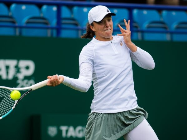 Iga Swiatek of Poland in action during the first round at the 2021 Viking International WTA 500 tennis tournament in Eastbourne