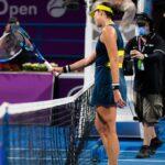 Maria Sakkari of Greece & Garbine Muguruza of Spain at the net after the quarter-final at the 2021 Qatar Total Open WTA 500 tournament