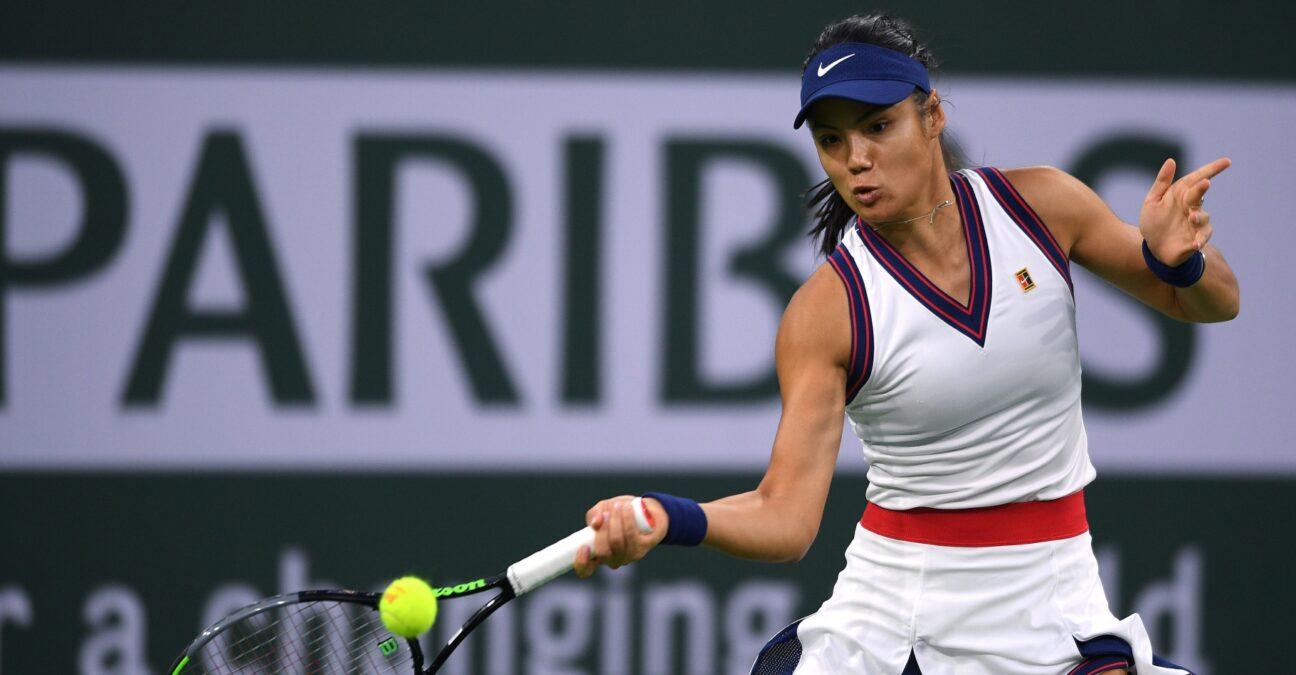 Emma Raducanu (GBR) hits a shot against Aliaksandra Sasnovich (BLR) at Indian Wells Tennis Garden.